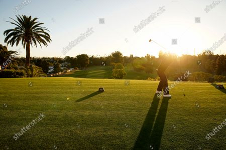 Stock Photo of Camilo Villegas, of Colombia, tees off on the first hole during the first round of the Genesis Invitational golf tournament at Riviera Country Club, in the Pacific Palisades area of Los Angeles