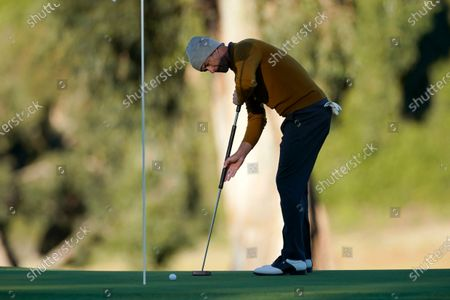 Adam Scott, of Australia, putts on the 10th hole during the first round of the Genesis Invitational golf tournament at Riviera Country Club, in the Pacific Palisades area of Los Angeles