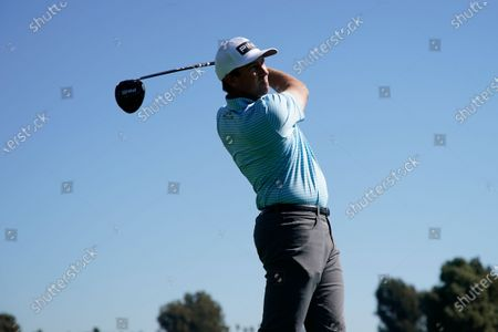 Michael Thompson tees off on the third hole during the first round of the Genesis Invitational golf tournament at Riviera Country Club, in the Pacific Palisades area of Los Angeles