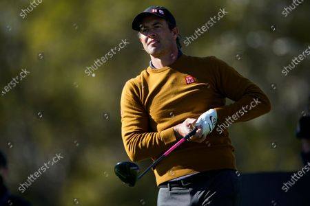 Adam Scott, of Australia, tees off on the 17th hole during the first round of the Genesis Invitational golf tournament at Riviera Country Club, in the Pacific Palisades area of Los Angeles