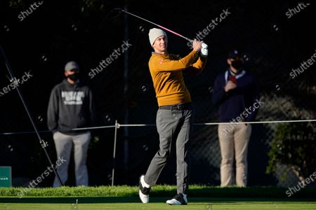Adam Scott, of Australia, tees off on the 11th hole during the first round of the Genesis Invitational golf tournament at Riviera Country Club, in the Pacific Palisades area of Los Angeles