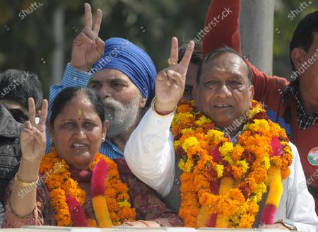 """Congress candidates Rishab Jain (ward no 20) and his wife Raj Rani Jain (ward no 19) in a jubilant mood after winning the municipal council election   on February 18, 2021 in Mohali, India. In a landslide victory in the civic body elections Wednesday, the Congress won 1,399 of the 2,165 municipal wards, and six of the eight municipal corporations. The results were a big boost for Chief Minister Amarinder Singh, with the elections seen as """"semi-finals"""" for the Assembly polls due early next year."""