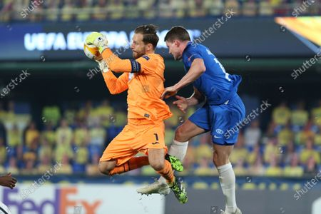 Stock Image of Hoffenheim's goalkeeper Oliver Baumann, left, competes for the ball with Molde's Bjorn Bergmann Sigurdarson during the Europa League round of 32 first leg soccer match between Molde and 1899 Hoffenheim at the Ceramica stadium in Villarreal, Spain