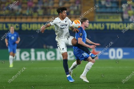 Hoffenheim's Chris Richards, left, competes for the ball with Molde's Bjorn Bergmann Sigurdarson during the Europa League round of 32 first leg soccer match between Molde and 1899 Hoffenheim at the Ceramica stadium in Villarreal, Spain