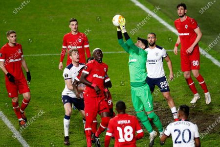 Royal Antwerp's goalkeeper Alireza Beiranvand, center, goes up for a save during the Europa League round of 32 first leg soccer match between Antwerp and Rangers at the Bosuil stadium in Antwerp, Belgium