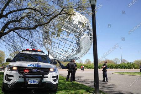 A view of NYPD  stands guard at Flushing Meadows Corona Park, Queens, New York, USA during Coronavirus pandemic on May 2, 2020. US NYC Mayor Di Blasio De Blasio Commits to 100 Miles of 'Open Streets'.