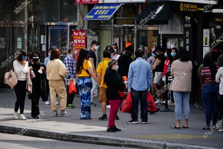 A view of people going about their business in Main Street, Flushing, Queens, USA during Coronavirus pandemic on May 2, 2020. (Photo by John Nacion/NurPhoto)