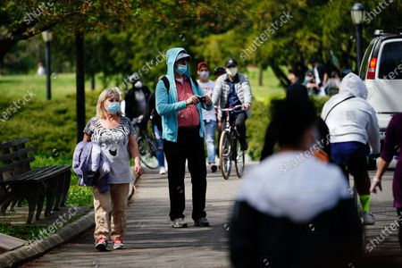 Stock Picture of A view people enjoying the weather at Flushing Meadows Corona Park, Queens, New York, USA during Coronavirus pandemic on May 2, 2020. US NYC Mayor Di Blasio De Blasio Commits to 100 Miles of 'Open Streets'.