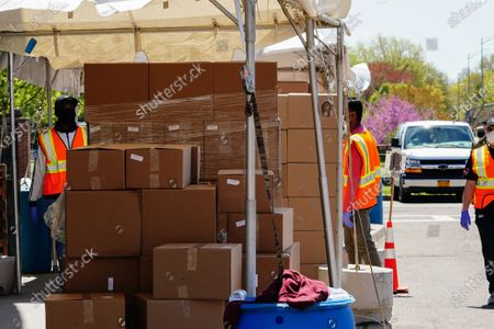 A view NYC City personnels and US Army distributing relief goods at Al Oerter Rec Center, Queens, New York, USA during Coronavirus pandemic on May 2, 2020. US NYC Mayor Di Blasio De Blasio Commits to 100 Miles of 'Open Streets'.