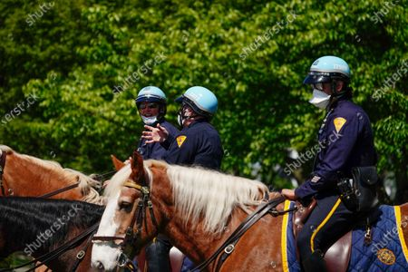 A view of NYPD mounted police stands guard at Flushing Meadows Corona Park, Queens, New York, USA during Coronavirus pandemic on May 2, 2020. US NYC Mayor Di Blasio De Blasio Commits to 100 Miles of 'Open Streets'.