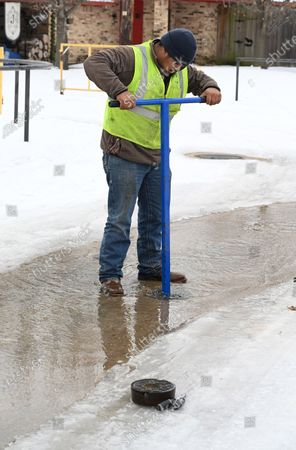 Public works crews work to repair broken water lines in Wylie, Texas on Thursday, February, 18, 2021. Record cold temperatures along with snow and ice caused power outages resulting in frozen water pipes. May parts of the state are under a boil water order due low water pressure.