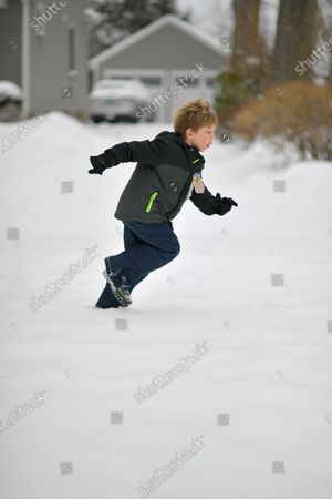 Jackson Walker plays in the fresh snow.