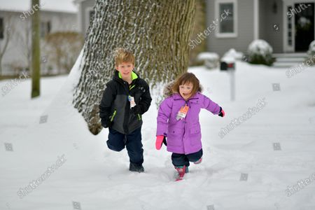 Jackson and Riley Walker play in the fresh snow.