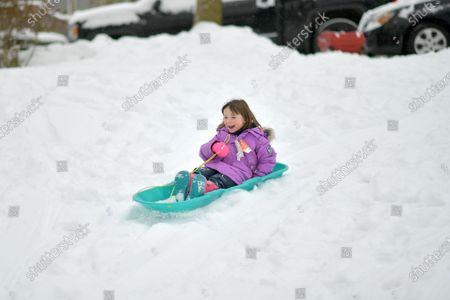 Riley Walker sleds down the hill.