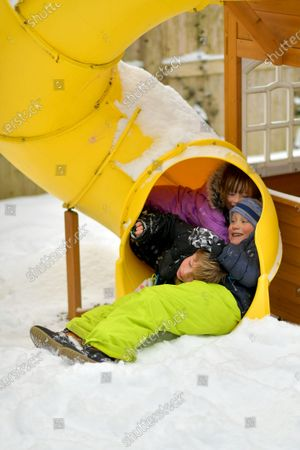 Stock Picture of Kids play in the new snow.