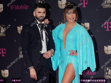 Jomari Goyso, left, and Luz Garcia arrive at Premio Lo Nuestro at American Airlines Arena, in Miami
