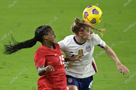 United States defender Becky Sauerbrunn (4) heads the ball in front of Canada forward Nichelle Prince (15) during the first half of a SheBelieves Cup women's soccer match, in Orlando, Fla
