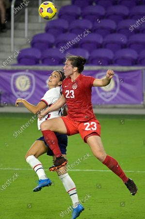United States forward Alex Morgan, left, and Canada defender Vanessa Gilles (23) compete for a ball during the second half of a SheBelieves Cup women's soccer match, in Orlando, Fla