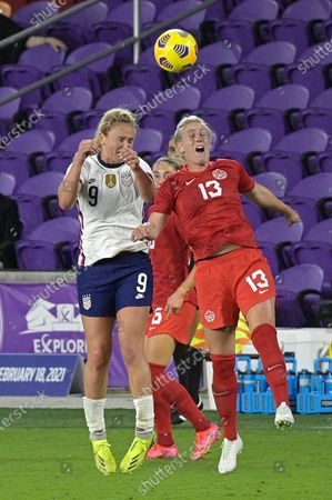 United States midfielder Lindsey Horan (9) and Canada midfielder Sophie Schmidt (13) compete for a header during the second half of a SheBelieves Cup women's soccer match, in Orlando, Fla