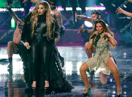 Stock Picture of Ivy Queen, left, and Gloria Trevi perform at Premio Lo Nuestro at American Airlines Arena, in Miami