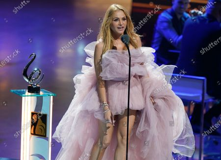 """Paulina Rubio accept the award for Cumbia song of the year for """"Tu y Yo"""" at Premio Lo Nuestro at American Airlines Arena, in Miami"""