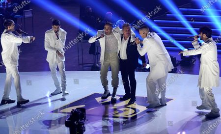 Ricardo Montaner, forth from left, and CNCO, perform at Premio Lo Nuestro at American Airlines Arena, in Miami