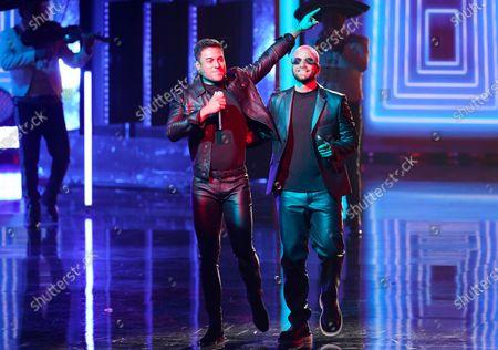 """Carlos Rivera, left, and Maluma perform """"100 Anos"""" at Premio Lo Nuestro at American Airlines Arena, in Miami"""