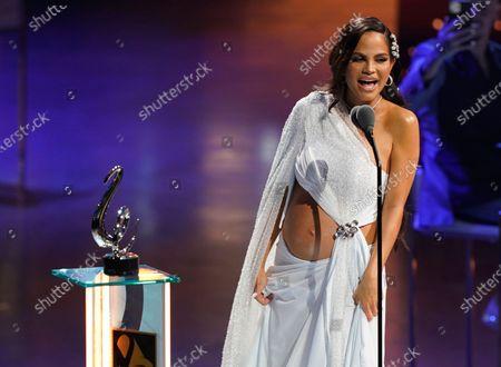 "Natti Natasha accepts the award for tropical song of the year for ""La Mejor Version De Mi"" at Premio Lo Nuestro at American Airlines Arena, in Miami"