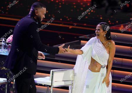 """Raphy Pina congratulates Natti Natasha, winner of the award for tropical song of the year for """"La Mejor Version De Mi"""" at Premio Lo Nuestro at American Airlines Arena, in Miami"""