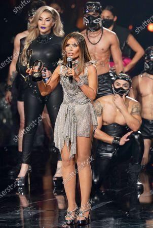 Stock Image of Gloria Trevi accepts the Premio a la Trayectoria at Premio Lo Nuestro at American Airlines Arena, in Miami