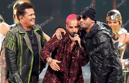 Carlos Vives, from left and Maluma present the excellence award to Wisin at Premio Lo Nuestro at American Airlines Arena, in Miami