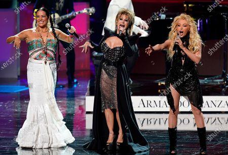 Lila Downs, from left, Alejandra Guzman and Yuri perform a tribute to Armando Manzanero at Premio Lo Nuestro at American Airlines Arena, in Miami