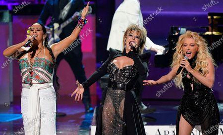Stock Photo of Lila Downs, from left, Alejandra Guzman and Yuri perform a tribute to Armando Manzanero at Premio Lo Nuestro at American Airlines Arena, in Miami