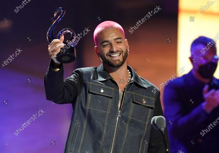 """Maluma accepts the award for pop song of the year for """"ADMV"""" at Premio Lo Nuestro at American Airlines Arena, in Miami"""