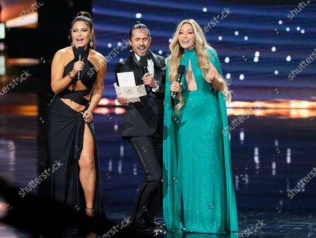 Chiquinquira Delgado, from left, Jose Ron and Yuri present the award for pop album of the year at Premio Lo Nuestro at American Airlines Arena, in Miami