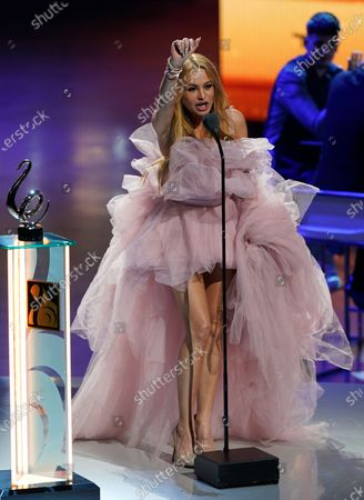 """Stock Picture of Paulina Rubio accept the award for Cumbia song of the year for """"Tu y Yo"""" at Premio Lo Nuestro at American Airlines Arena, in Miami"""