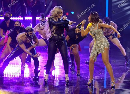 Ivy Queen, left, and Gloria Trevi perform at Premio Lo Nuestro at American Airlines Arena, in Miami
