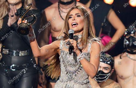Ivy Queen, left, hugs Gloria Trevi as Trevi accepts the Premio a la Trayectoria at Premio Lo Nuestro at American Airlines Arena, in Miami