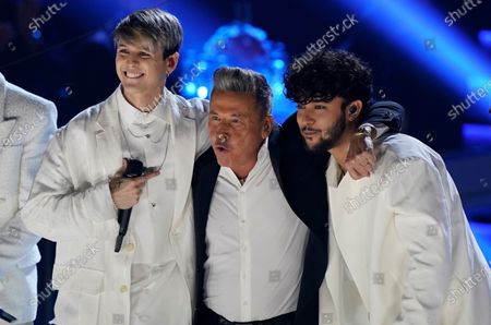 Stock Image of Christopher Velez, from left, and Joel Pimentel, of CNCO and Ricardo Montaner perform at Premio Lo Nuestro at American Airlines Arena, in Miami