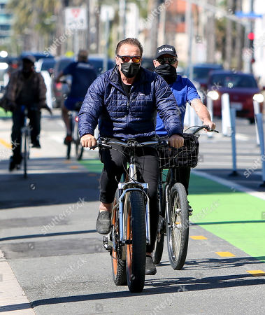 Stock Photo of Arnold Schwarzenegger seen out for a bike ride on a sunny afternoon