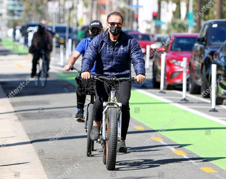 Stock Picture of Arnold Schwarzenegger seen out for a bike ride on a sunny afternoon