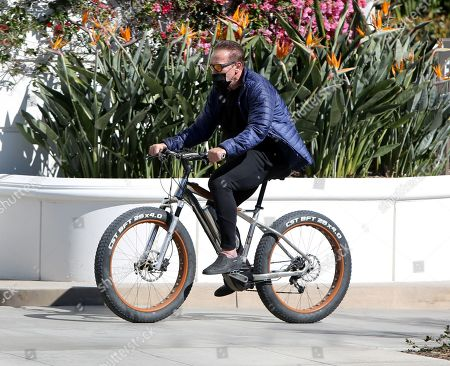 Arnold Schwarzenegger seen out for a bike ride on a sunny afternoon