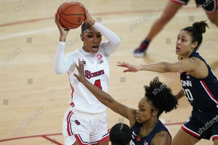 St. John's forward Raven Farley (4) looks to pass as Connecticut forward Olivia Nelson-Ododa (20) and Connecticut guard Christyn Williams defend her during the second quarter of an NCAA college basketball game, at St. John's University in New York
