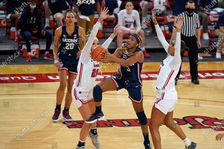 St. John's forwards Rayven Peeples (20) and Raven Farley (4) defend Connecticut forward Aaliyah Edwards (3) as Connecticut forward Olivia Nelson-Ododa (20) looks on during the third quarter of an NCAA college basketball game, at St. John's University in New York