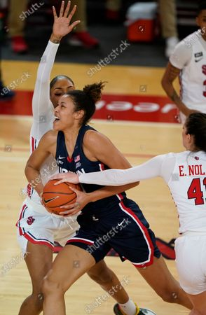 St. John's forward Raven Farley (4) and St. John's forward Emma Nolan (41) defend Connecticut forward Olivia Nelson-Ododa (20) during the second quarter of an NCAA college basketball game, at St. John's University in New York