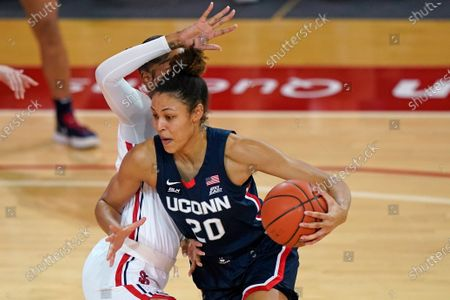 Connecticut forward Olivia Nelson-Ododa (20) drives around St. John's forward Raven Farley during the first half of an NCAA college basketball game, at St. John's University in the Queens borough of New York