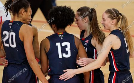 Stock Picture of Connecticut guard Paige Bueckers, far right, gathers with teammates, from left Connecticut forward Olivia Nelson-Ododa (20), and guards Evina Westbrook, Christyn Williams (13), and Nika Muhl (10) as they huddle during the second quarter of an NCAA college basketball game against St. John's, at St. John's University in New York. Bueckers leads the nation in 3-point shooting, hitting just under 56% of her attempts and is UConn's leader in scoring (21.1 points per game), minutes played (36.5), assists (100) and steals (40