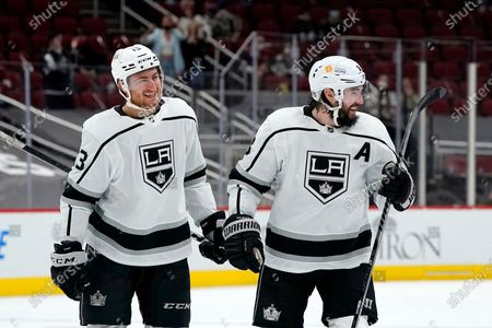Los Angeles Kings' Gabriel Vilardi, left, and Kings' Drew Doughty, right, smile after a shootout win in an NHL hockey game against the Arizona Coyotes in which Vilardi scored the game winner, in Glendale, Ariz. The Kings defeated the Coyotes 3-2