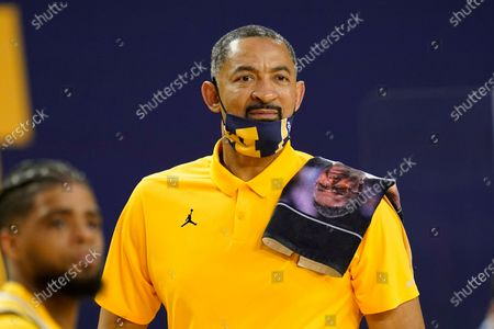 Stock Photo of Michigan Wolverines head coach Juwan Howard has a towel honoring former Georgetown head coach John Thompson on his shoulder in the second half of an NCAA college basketball game in Ann Arbor, Mich
