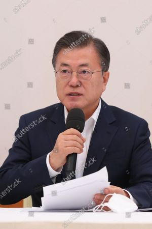 South Korean President Moon Jae-in speaks during a meeting with the ruling Democratic Party's leadership, including its chief Lee Nak-yon, at the presidential office Cheong Wa Dae in Seoul, South Korea, 19 February 2021.